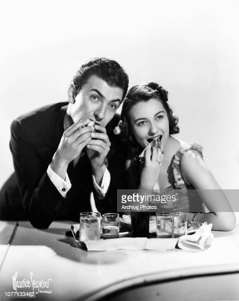 American pianist and bandleader Eddy Duchin shares a snack with singer Durelle Alexander 1938