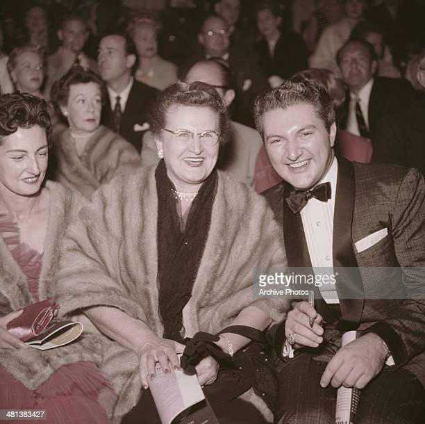 American pianist and singer Liberace with his mother Frances circa 1955
