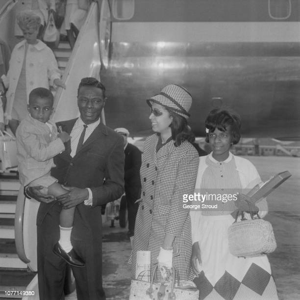 American pianist and singer Nat King Cole pictured with his wife Maria Cole daugher Natalie Cole and son Nat Kelly Cole as they arrive at London...