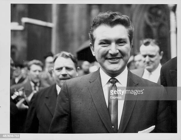 American pianist Liberace smiling as he leaves court following libel action against the Daily Mail over a slanderous article London June 9th 1959