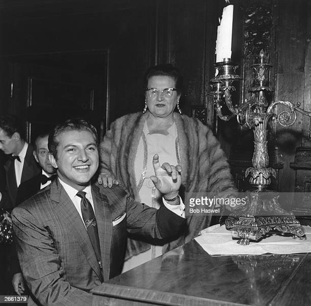 American pianist Liberace with his mother Liberace developed an act of popular piano classics performed with lavish showmanship