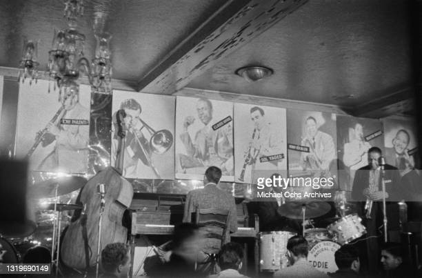 American pianist Marty Napoleon , American drummer Cozy Cole , and American trumpeter Henry 'Red' Allen perform at an unspecified nightclub in New...