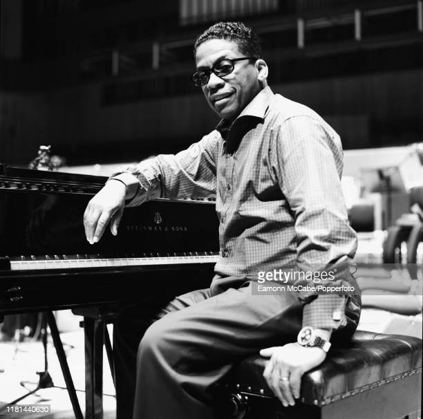 American pianist musician and composer Herbie Hancock seated at a piano during a soundcheck prior to a concert in London in 2000