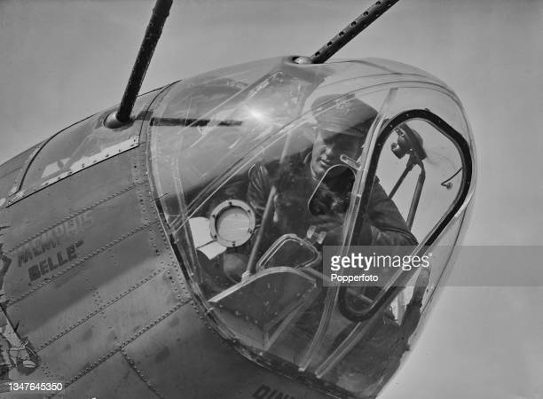 American pilot Captain Robert K Morgan of the United States Army Air Forces is joined with Scottie the mascot dog in the front turret of his Boeing...