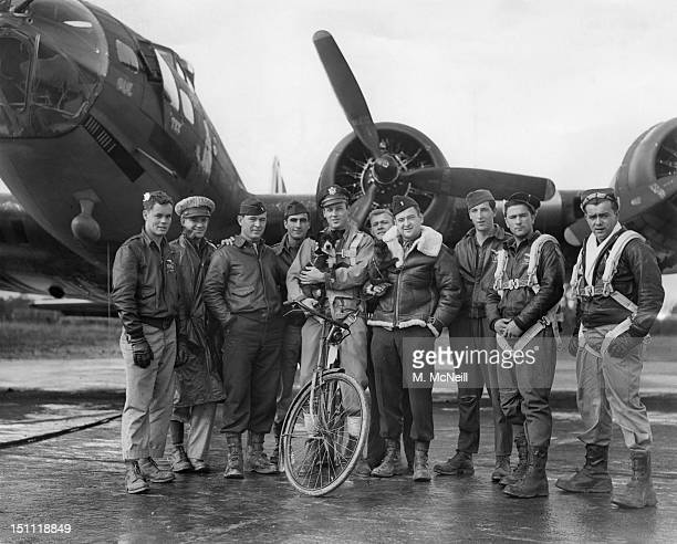 American pilot Robert W Biesecker and his crew standing by their B17 Flying Fortress bomber 'Honey Chile' at a US Eighth Air Force station in England...