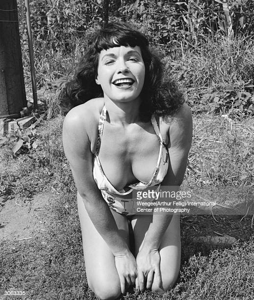 American pinup Bettie Page Playboy playmate of the month for January 1955 shows off her cleavage in a bikini New York state 1956 Photo by...