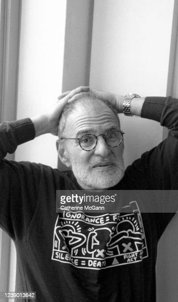 American playwright and gay rights activist Larry Kramer poses for a portrait wearing a shirt designed by American artist Keith Haring at Kramer's...