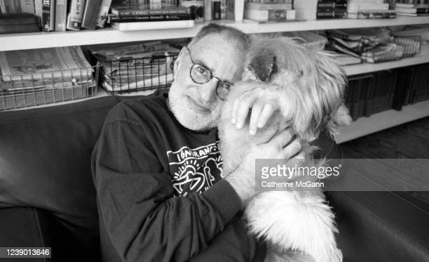 American playwright and gay rights activist Larry Kramer poses for a portrait with his dog at his apartment in April 1993 in New York City New York n