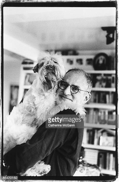 American playwright and gay rights activist Larry Kramer poses for a portrait with his dog at his apartment in April 1993 in New York City New York