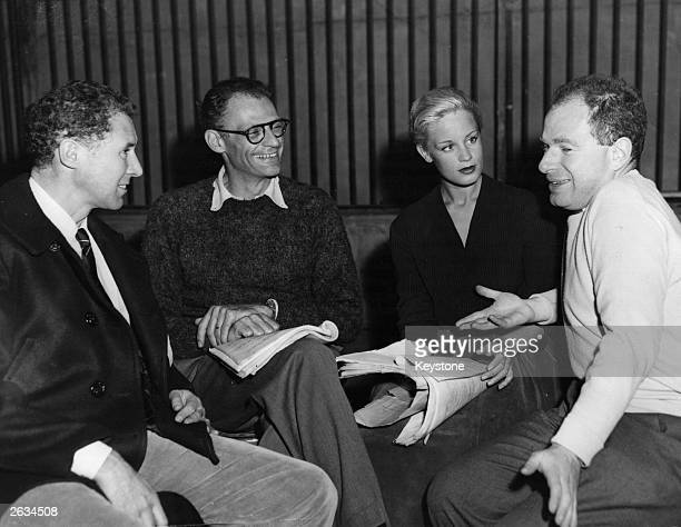 American playwright Arthur Miller with actors Anthony Quayle and Mary Ure , and Peter Brook, the producer. They are discussing the script of his new...