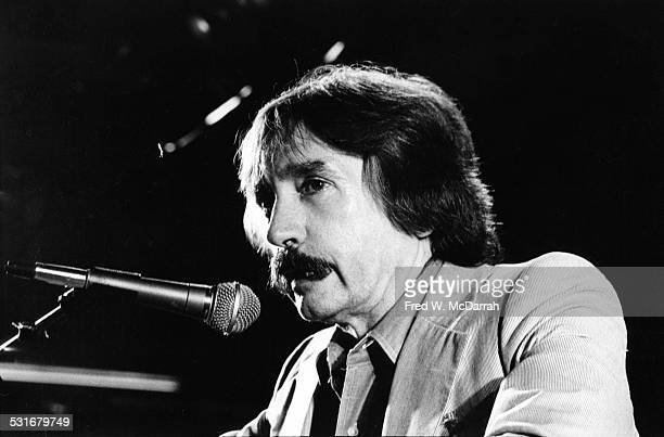 American playwright Edward Albee speaks into a microphone at the Obie Award ceremony New York New York June 2 1980