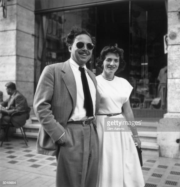 American playwright Tennessee Williams and a lady friend standing on the Via Veneto outside the Excelsior hotel in Rome