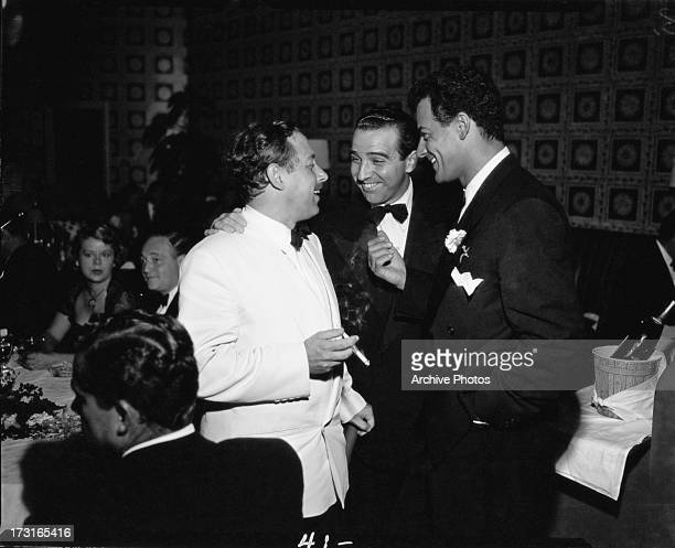 American playwright Tennessee Williams with actor Cornel Wilde at a party, Hollywood, circa 1950.