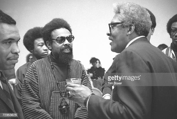 American poet Amiri Baraka listens as American Civil Rights leader Bayard Rustin speaks 1969
