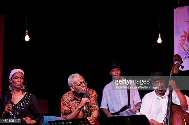 American poet and activist Amiri Baraka born Everett LeRoi Jones reads the words to songs by Curtis Mayfield as William Parker on upright acoustic...