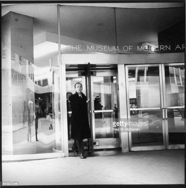 American poet and museum curator Frank O'Hara walks through a revolving as he walks out of the Museum of Modern Art New York New York January 20 1960