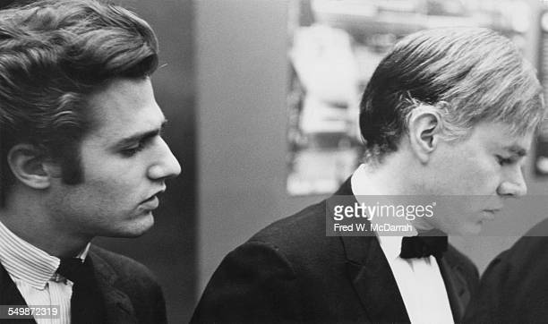 American poet Gerard Malanga and Pop artist Andy Warhol attend an event at the Museum of Modern Art