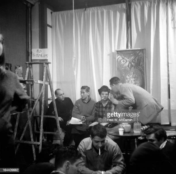 American poet Gregory Corso and Filipino poet Jose Garcia Villa sit on a sofa at an unidentified venue New York New York February 15 1959