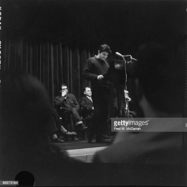 American poet Gregory Corso reads from his poem 'Marriage' at Columbia University New York New York February 5 1959 On stage behind him are fellow...