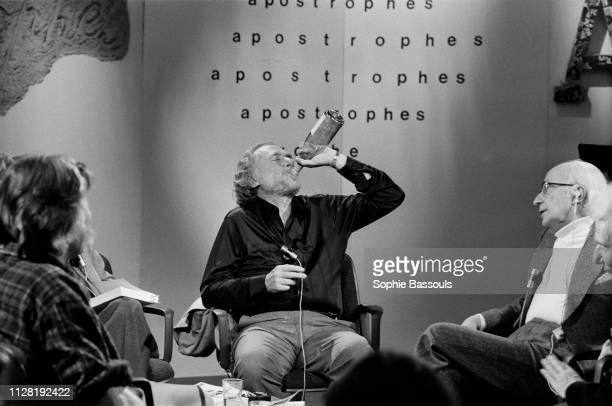 American poet novelist and short story writer Charles Bukowski drinking on the set of the French TV program Apostrophes hosted by Bernard Pivot