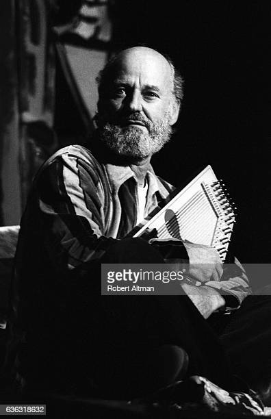 American poet painter and liberal activist Lawrence Ferlinghetti poses for a portrait while playing an autoharp circa 1971 in San Francisco California