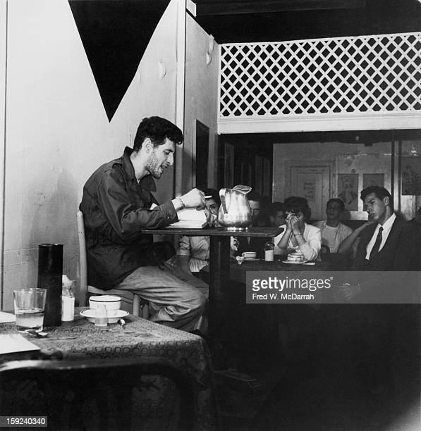 American poet Ray Bremser reads from his work 'Poems of Holy Madness' at the Epitome Café New York New York June 6 1959