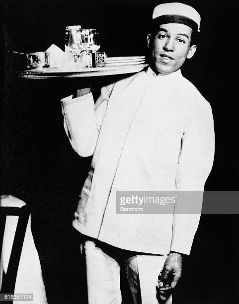 American poet, social activist, novelist, playwright, and columnist Langston Hughes working as a waiter, 5th December 1925.