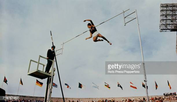 American pole vaulter Bob Seagren pictured setting a new Olympic record as he clears the bar in competition to finish in first place to win the gold...