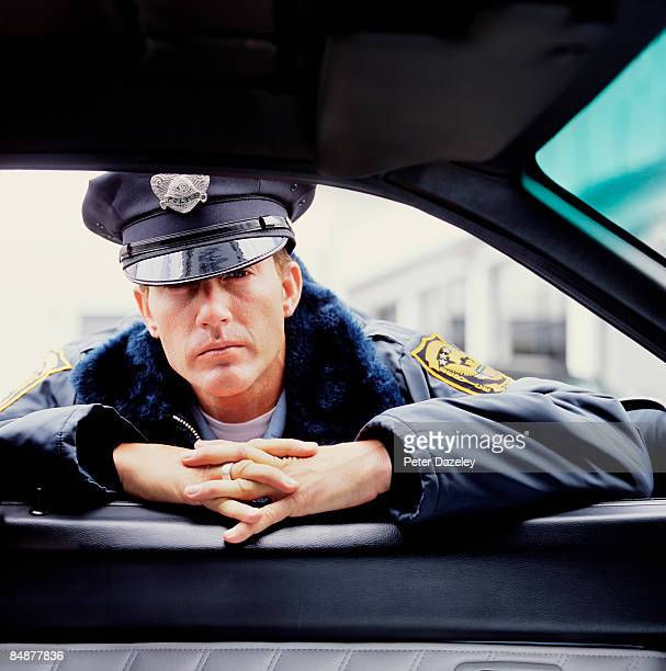 American Policeman beside car