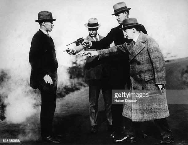 American policemen demonstrate at close range the efficiency of a new bulletproof vest