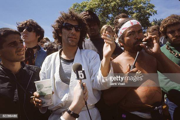 American political activist Abbott Abbie Hoffman speaks to a journalist from the midst of a crowd of demonstators gathered in protest of the...