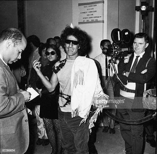 American political activist Abbott Abbie Hoffman speaks to reporters after arriving in Washington to attend the UnAmerican Activities Hearings...
