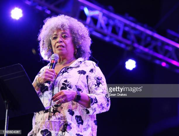 American political activist, academic and author Angela Davis reads a statement during NPR Music's Turning the Tables Live: The Motherlode as part of...