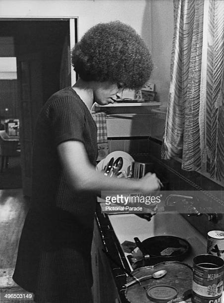 American political activist and academic Angela Davis, in a kitchen, circa 1970.