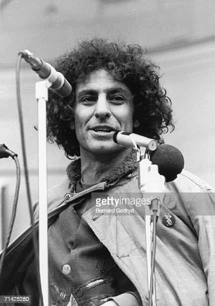 American political activist and cofounder of the Youth International Party Abbie Hoffman speaks into microphones as he addresses a crowd at a...