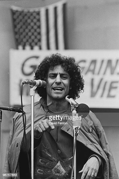 American political and social activist Abbie Hoffman speaks from behind a bank of microphones at a rally against the war in Vietnam late 1960s or...
