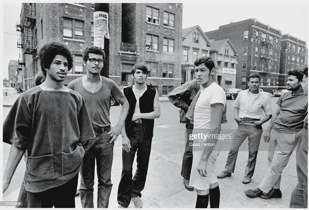American political and social activist Felipe Luciano (left) and members of the Young Lords Organization (of which Luciano was a co-founder) stand on a street corner in Newark, New Jersey, July 23, 1970. The Young Lords sought promote Hispanic nationalism, self-determination, and education, and to improve social services in Puerto Rican neighborhoods.