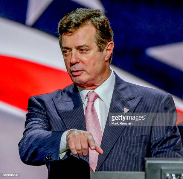 American political lobbyits and Trump campaign manager Paul Manafort points during a microphone sound check on the main stage of the Quicken Arena...