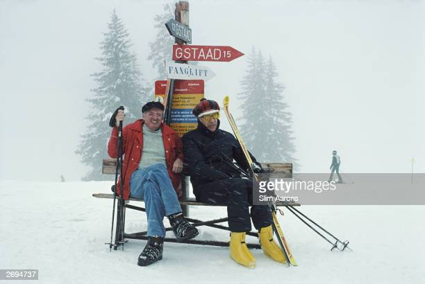 American political novelist William F Buckley Jnr takes a break from skiing near Gstaad with Canadianborn economist John Kenneth Galbraith