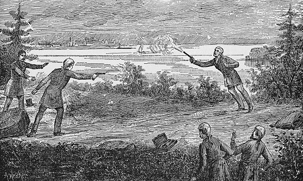 American politician Aaron Burr fatally wounds Alexander Hamilton with a shot from his pistol during a duel in Weehawken, New Jersey, July 11, 1804....