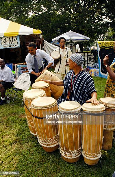 American politician and and Illinois state senator Barack Obama plays drums at the African Festival of the Arts Chicago Illinois early September 2004