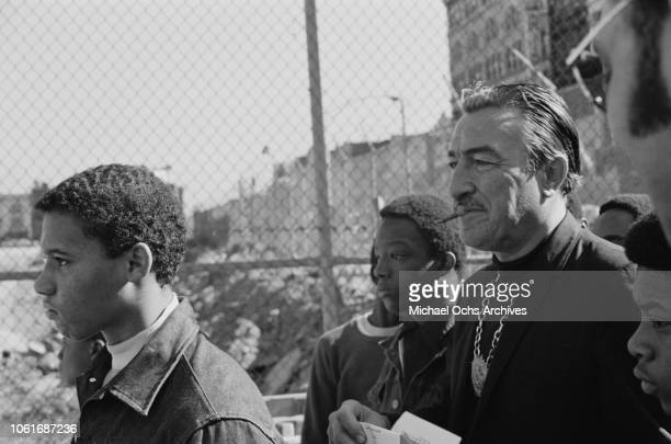 American politician and Baptist pastor Adam Clayton Powell Jr the representative for Harlem in the US House of Representatives tours his constituency...
