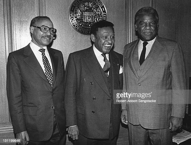 American politician and Chicago Mayor Harold Washington poses with newspaper publisher John H. Sengstacke and an unidentified man, 1980s.