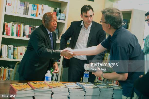 American politician and Civil Rights activist US Representative John Lewis shakes hands with unidentified man at a book signing during the Montreat...