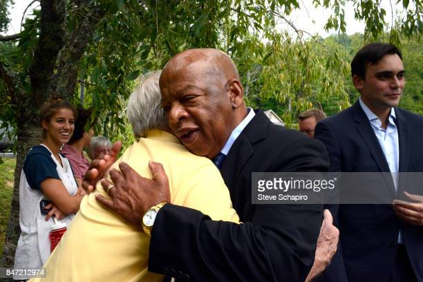 American politician and Civil Rights activist US Representative John Lewis embraces an unidentified man outside the Montreat Conference Center during...