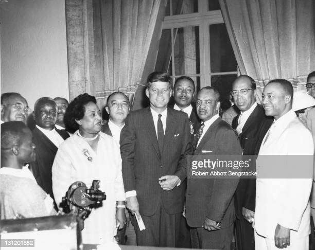 American politician and Democratic Party presidentianl nominee John F Kennedy poses with an unidentified group of delegates at the Democratic...