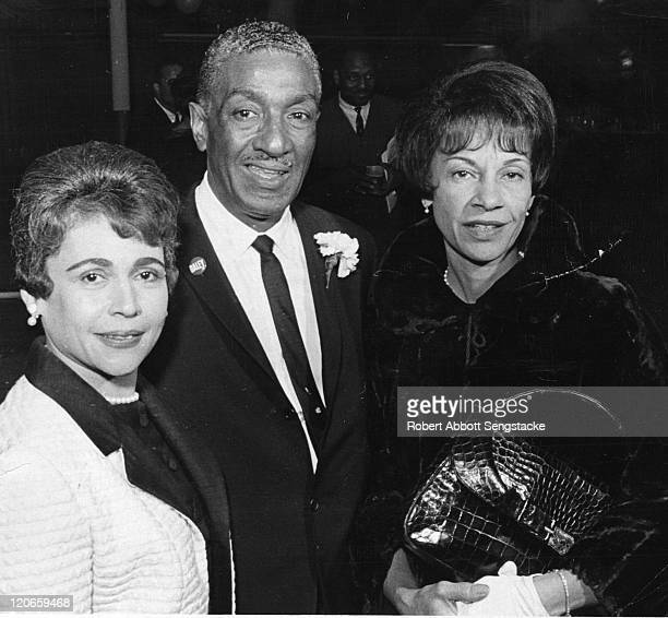 American politician and former athlete Ralph Metcalfe poses with Myrtle Sengstacke and an unidentified woman, 1960s. Metcalfe wears a campaign button...