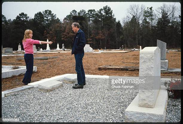 American politician and former US President Jimmy Carter and his daughter Amy visit the Carter family plot in Lebanon Cemetery Plains Georgia January...