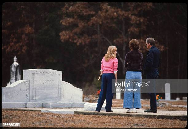 American politician and former US President Jimmy Carter his wife Rosalynn and his daughter Amy visit the Carter family plot in Lebanon Cemetery...