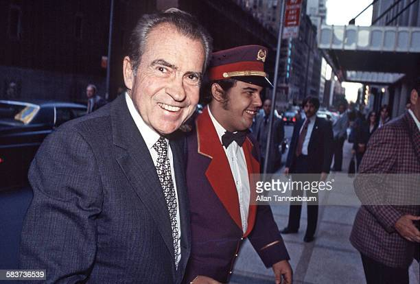 American politician and former US President Richard M Nixon smiles as he arrives at the Waldorf Astoria Hotel, New York, New York, 1970s or 1980s.